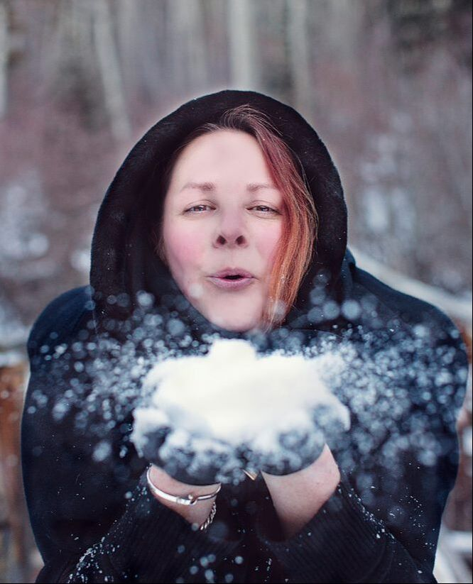 Photo of Urban Dweller editor, Karen Pellegrin, blowing snow at the camera